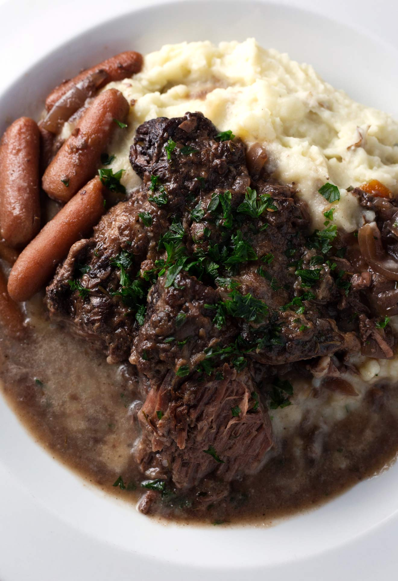 Red Wine Braised Beef with Carrots, Onion, and Garlic   Easy one-pot meal that is downright comfort food.