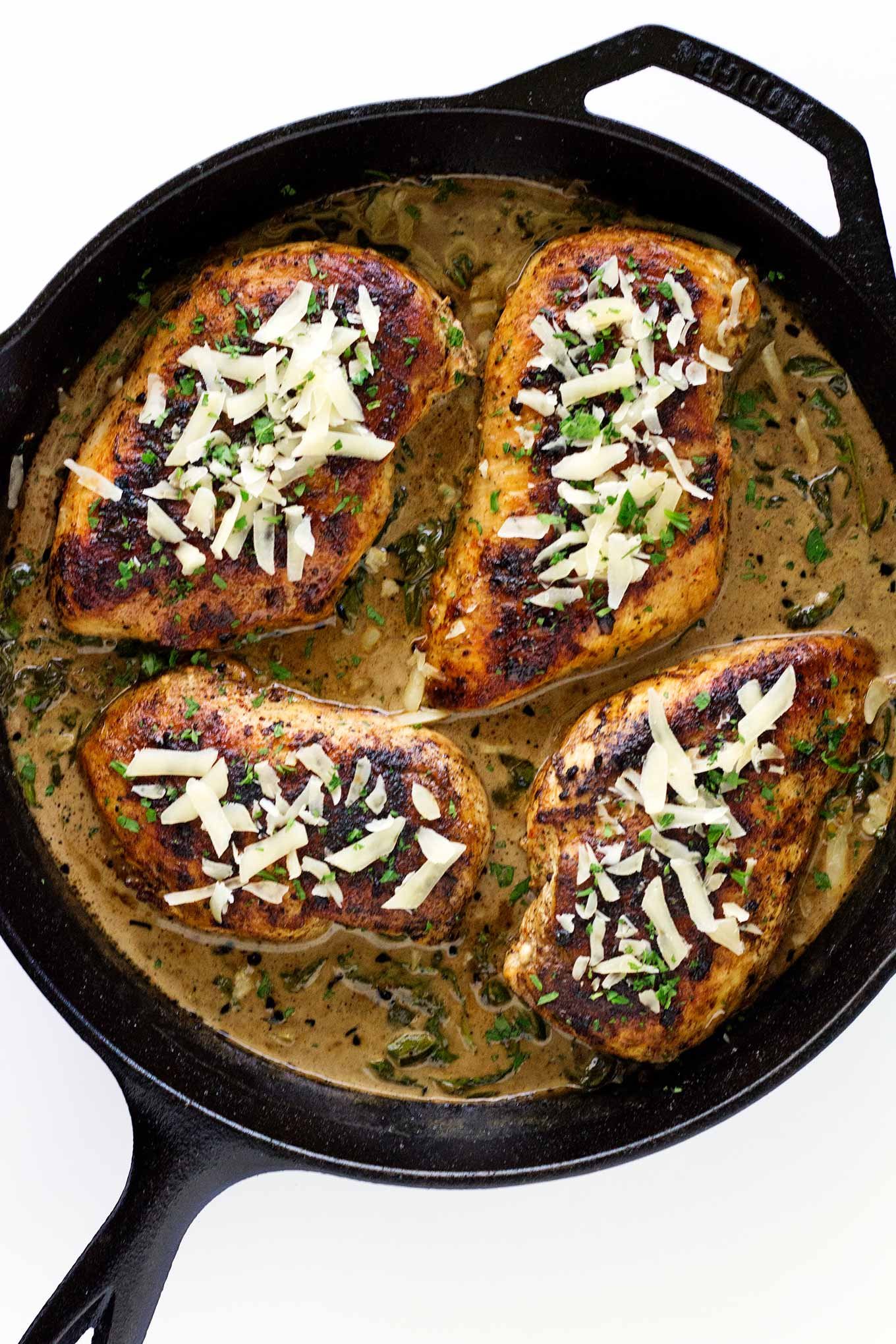 These chicken breasts are seasoned and seared to perfection then placed in a delicious lemon butter parmesan garlic cream sauce. And it's all made in one skillet and will leave you drooling for more!