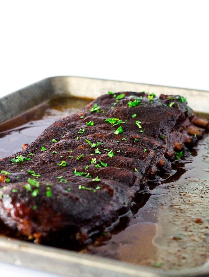 These oven baked ribs are seasoned with a rub then slow baked to perfection right in your oven. Topped with a homemade BBQ sauce that is sure to satisfy your tastebuds.