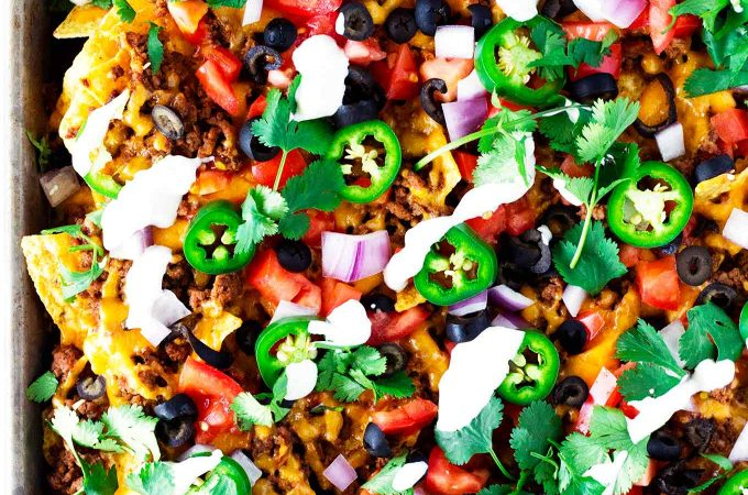 These easy sheet pan nachos are great as an appetizer for a crowd or for a quick and easy dinner!